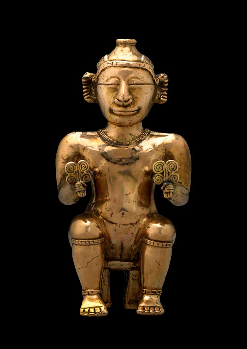 Seated female poporo, Quimbaya, gold alloy, AD600-1100. Copyright the Trustees of the British Museum.
