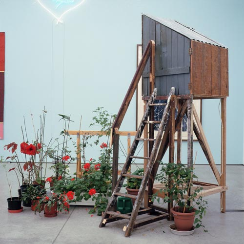 Tracey Emin. The Perfect Place to Grow, 2001. Mixed media: wooden birdhouse, DVD (1 minute 45 seconds), monitor, trestle, plants and ladder, 261 x 82.5 x 162. Tate: purchased 2004. © The Artist