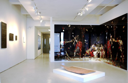 Rashid Rana. War Within II [installation view], 2013. C Print + DIASEC, 94.5 x 236 in (240 x 600 cm) (in two parts). Courtesy the artist.
