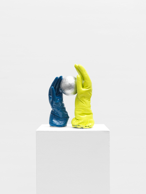 Tamar Ettun. Blue Glove with Yellow-Green Glove with a Ball, 2015. Plaster, paint, cardboard, 12 x 9 x 6 in.