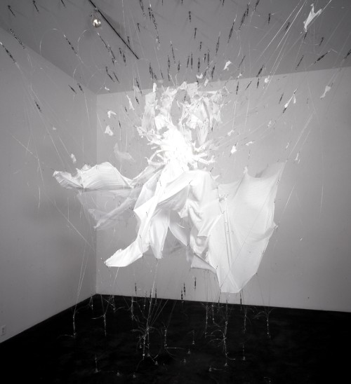 E.V. Day. Bombshell, 1999. from the series Exploding Couture. White crepe dress with monofilament and turnbuckles. 192 x 240 x 240 in. Whitney Museum of American Art, New York. Courtesy of the artist.