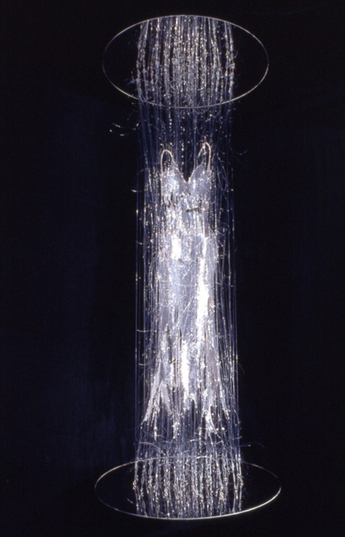 E.V. Day. Transporter, 2000. Silver sequin dress with monofilament, turnbuckles and mirrored disks. 115 x 48 x 48 in. Collection of Heather and Tony Podesta, Falls Church, VA. Courtesy of the artist.