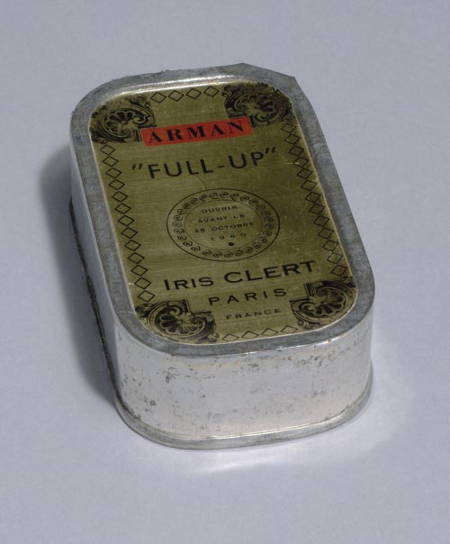 Arman. (American, born France, 1928-2005). <em>Le Plein (Full Up)</em>, 1960. Multiple of sardine can filled with trash and exhibition invitation, overall: 4 1/8 x 2 x 1 1/8 in (10.5 x 6.4 x 2.9 cm). Publisher: Galerie Iris Clert, Paris. Fabricator: the artist and Galerie Iris Clert, Paris. Edition: 1,500; plus 500 signed and numbered. The Museum of Modern Art, New York. The Associates Fund, 2006. &copy; 2006 Artists Rights Society (ARS), New YorkADAGP, Paris.
