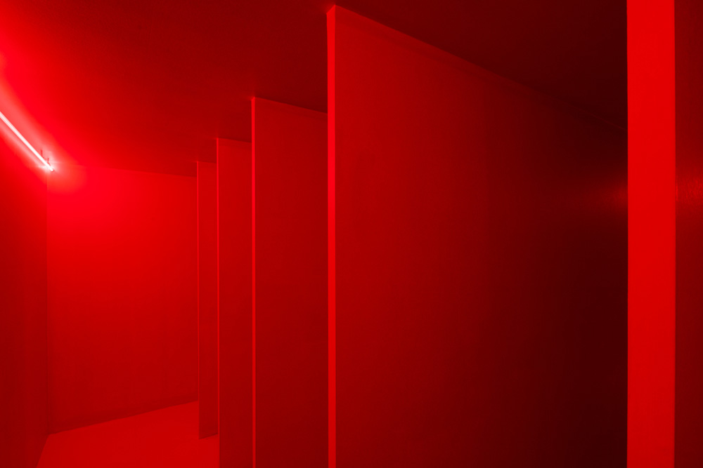 Lucio Fontana, Spatial Environment in Red, 1967/2019. Painted wood, glass tubes, neon and mixed media, 220 x 600 x 490 cm. Reconstruction authorised by  Fondazione Lucio Fontana, Milan - project Pirelli HangerBiocca 2017.