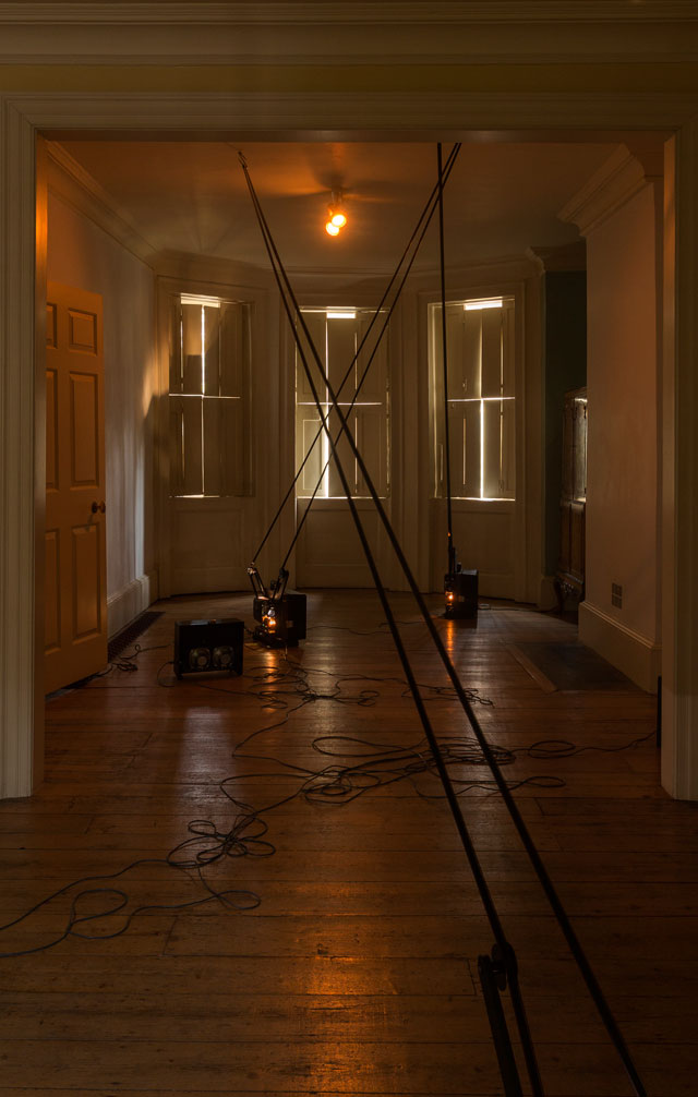 Louisa Fairclough. FEAR LIFE DEATH HOPE, 2017. 4 x 16mm projectors, 4 x film loops with optical sound suspended from meat hooks. Installation view: A Song cycle for the Ruins of a Psychiatric Unit, Danielle Arnaud Gallery, 2017. Photograph: Oskar Proctor. Courtesy the artist and Danielle Arnaud.