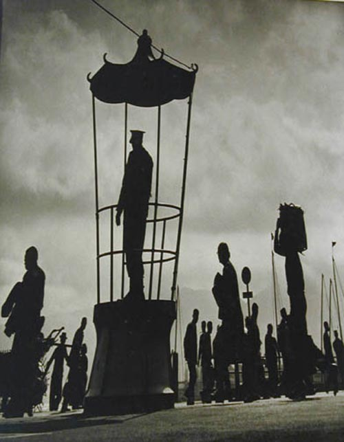 Fan Ho. <em>At the Crossroad</em>, c. 1960. 17 x 13.375-inch gelatin silver print. Courtesy Laurence Miller Gallery, New York.