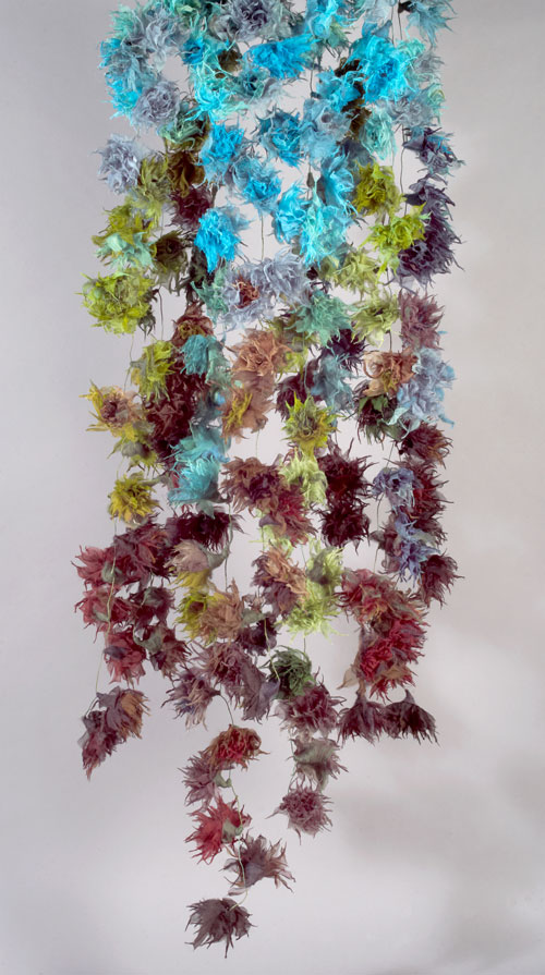 Yuh Okano. <em>Flower: Coming Events Cast Their Shadow Before</em>, 2010. Silk, partially felted with raw wool; hand-formed corsages. 71 × 20 in. (180 × 50 cm). Courtesy of the artist.