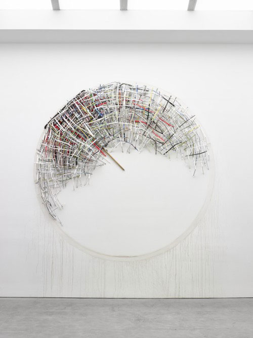 Mark Fox. In A Fool's House, 2013. Watercolour, ink acrylic, gouache, oil, colour pencil, graphite, marker, pen, crayon on paper, found broom, gallery dirt, 144 inch diameter. Courtesy of the artist.