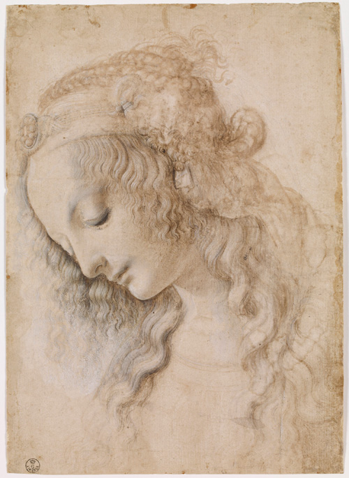 Leonardo da Vinci. <em>Head of a woman</em>, 1470s. Black chalk or leadpoint, brown and grey-black wash, heightened with white. This was done when the young Leonardo was working in Verrocchio's studio. Copyright the Gabinetto Disegni e Stampe degli Uffizi.