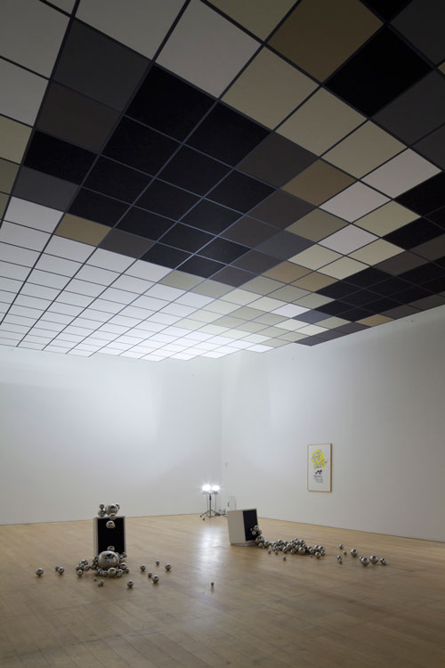 <p>Saâdane Afif. <em>The Skull</em>, 2008. Rockwool double ceiling, painted wood bases, stainless steel ball, lights, dimensions variable. Collection: Fonds National d'Art Contemporain (FNAC), Paris. Courtesy: Galerie Michel Rein, Paris. Photo: Watanabe Osamu Photo. Courtesy: Mori Art Museum.