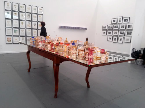 Valeska Soares. Finale, 2013. Antique table, antique glasses, wavy mirror and liquor, 78.7 x 335.3 x 92.1 cm. Galeria Fortes Vilaça, Sao Paulo.