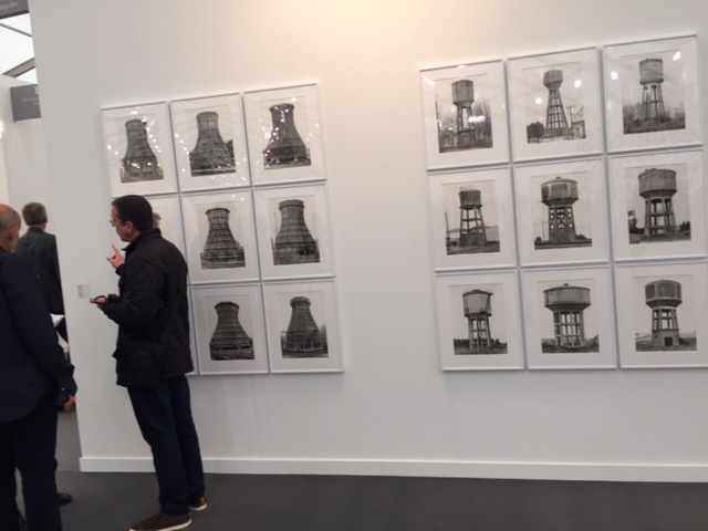 Bernd + Hilla Becher. (Left) Cooling Towers, 1969-92. Nine silver-gelatin prints, each 40 x 30 cm; (Right) Water Towers, 1967-80. Nine silver-gelatin prints, each 40 x 30 cm. Sprüth Magers. Photograph: Jill Spalding.