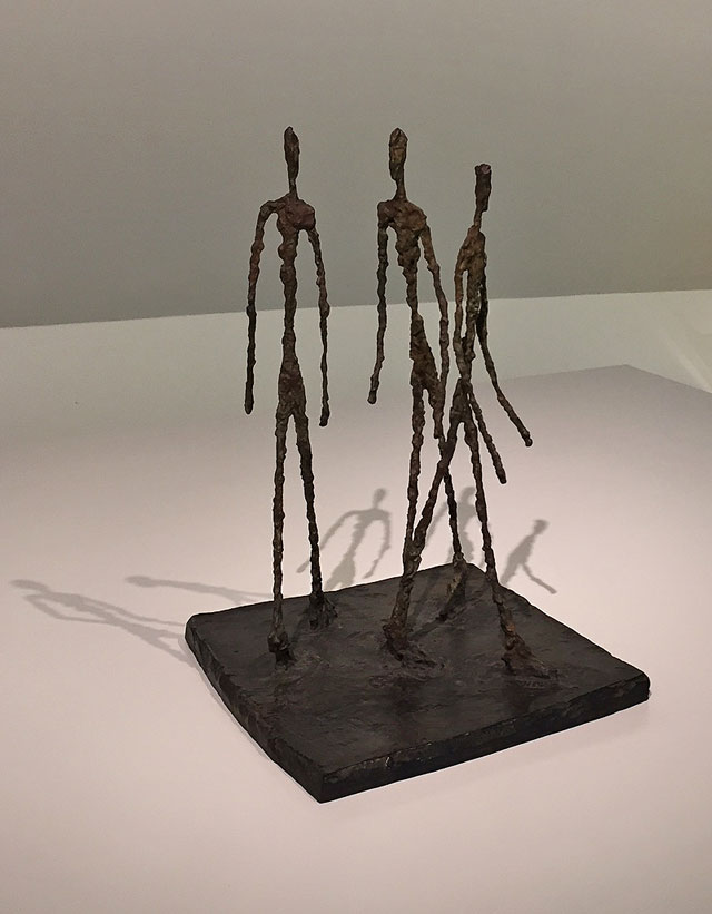 Alberto Giacometti. Three Men Walking (Small Square), 1948 (cast 2007). Bronze, 28 3/8 x 12 7/8 x 13 7/16 in (72 x 32.7 x 34.1 cm). Fondation Giacometti, Paris. Photograph: Jill Spalding.
