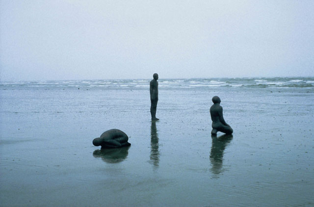 Antony Gormley. LAND SEA AND AIR II, 1982.Lead and fibreglass.  Land (crouching), 45 x 103 x 50 cm; Sea (standing), 191 x 50 x 32 cm; Air (kneeling), 118 x 69 x 52 cm. © the artist.