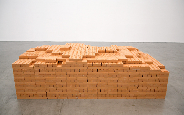 Shilpa Gupta. Threat, 2008-09. Bathing soaps, each 15 x 6.2 x 4 cm (5.9 x 2.5 x 1.6 in). Stack of 4,500 soaps, 72 x 229 x 107 cm (28.5 x 90 x 42 in). Visitors were invited to take a soap each.