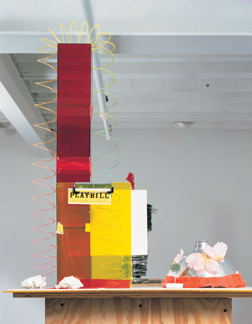 Isa Genzken. Fuck the Bauhaus #4, 2000. Plywood, Plexiglas, plastic slinky, clipboards, aluminum light shade, flower petals, tape, printed paper, shells, and model tree, 224 x 77 x 61 cm. Private Collection, Turin. Courtesy AC Project Room, New York. © Isa Genzken.