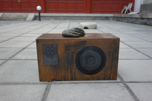 Anita Glesta. Sound sculpture with figure on top (hand), installed in the courtyard.