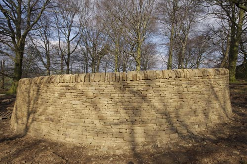 Andy Goldsworthy. <em>Outclosure</em>, 2007. Round wood and Yorkshire sandstone, quarried by Johnson's Wellfield, Huddersfield. Sited with permission of Job Earnshaw and Bros Ltd. Photo: Jonty Wilde.