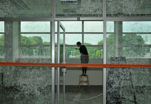 Gosia Wlodarczak. <em>Frost Drawing For Kallang, </em>2011. Performative drawing on glass  (<em>in situ</em>), at the Old Kallang Airport, Singapore.