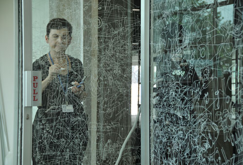 Gosia Wlodarczak. <em>Frost Drawing For Kallang, </em>2011, image 2. Performative drawing on glass  (<em>in situ</em>), at the Old Kallang Airport, Singapore.