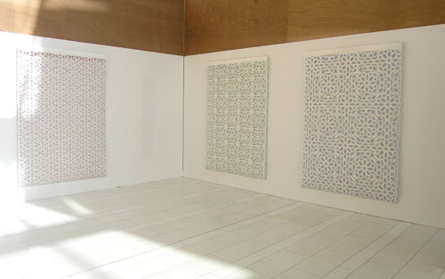 Reni Gower/Tamin Sahebzada. Installation view: (left to right) Papercuts: White/copper, Papercuts: White/emerald, Papercuts: White/cobalt, 81 x 56 in each, and Tamim Sahebzada, Wall tracing 60 x 10 in.