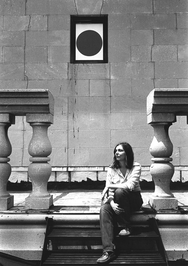Portrait of Nancy Holt taken on the steps up to the Clocktower Gallery, New York (1974). Photograph: Gwenn Thomas. © Holt/Smithson Foundation, Licensed by VAGA at ARS, New York.