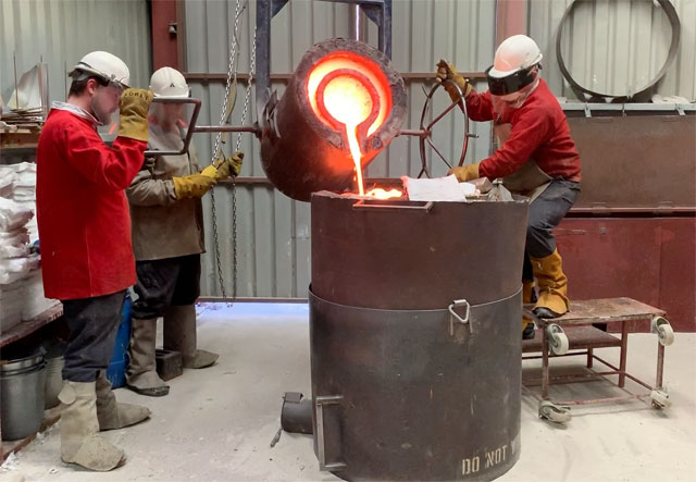 Pouring bronze into moulds at Castle Fine Arts Foundry, Wales. Photo: Martin Kennedy.