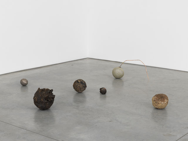 Jay Heikes. Minor Planets, 2017. Group of six orbs; steel slag, glue, gladstone orb, cast bronze, lignum vitae, cast bismuth, aluminium, copper, dimensions variable. Courtesy of the artist and Marianne Boesky Gallery, New York and Aspen. © Jay Heikes. Photograph: Jason Wyche.