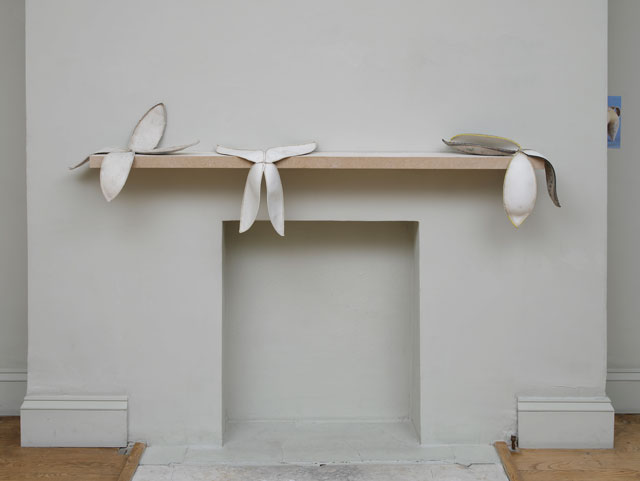 Nicky Hirst. 'Trophy' is a grouping of Trophy 1, Trophy II and Trophy III (2015), rejected rugby balls dissected to expose their fragile, petal-like interiors. Placed on unpainted particle-board shelf masquerading as mantelpiece, 45 × 45 cm. Courtesy the artist and Domobaal. Photograph: Andy Keate.