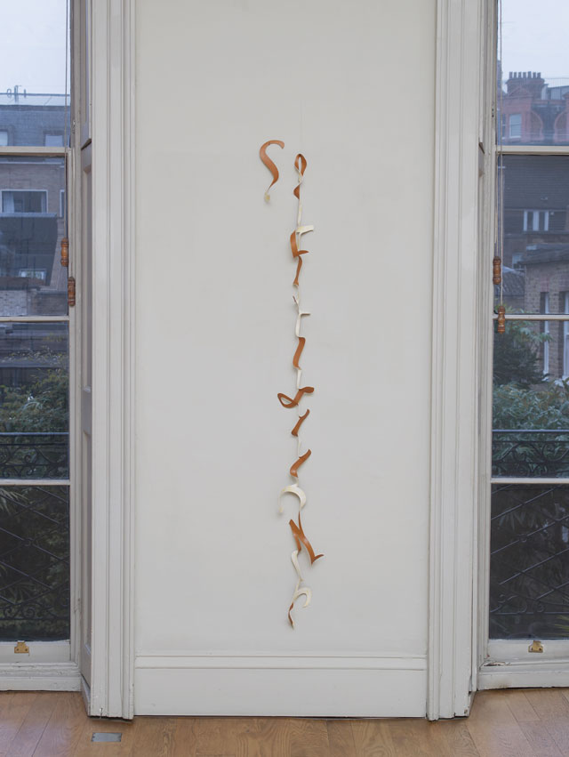 Nicky Hirst. Sehensucht, 2013. Leatherette, 170 × 17 cm. (The German word Sehensucht [longing] is sculpted in longhand lettering cut from a leatherette remnant). Courtesy the artist and Domobaal. Photograph: Andy Keate.