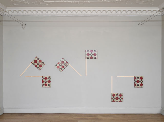 Nicky Hirst. All at Sea, 2017. Found linoleum on linen board, with wood, six pieces, each 40 × 91 cm. Semaphor flags spell out the letters WTF. Courtesy the artist and Domobaal. Photograph: Andy Keate.