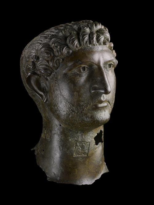 Bronze head from a statue of the emperor Hadrian, Roman Britain, AD 120–130. Found in the River Thames near London Bridge in 1834. © The Trustees of the British Museum.