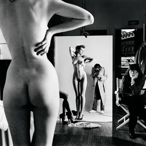 Helmut Newton. <em>Self-portrait with wife and models</em>, Paris, 1981. © Helmut Newton Estate.