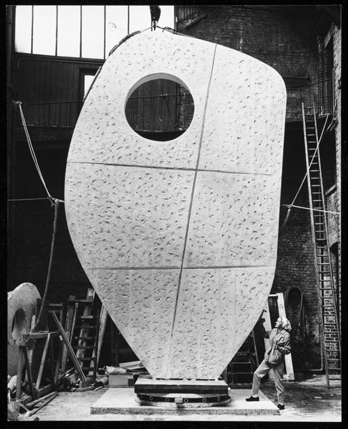 Barbara Hepworth with the plaster of Single Form 1961-4 at the Morris Singer foundry, London, May 1963. Photograph, gelatin silver print on paper. Photograph: Morgan-Wells. © Bowness