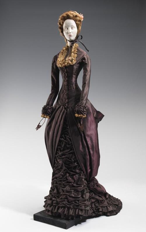 Christian Dior (French, 1905–1957). <em>Doll (for gratitude train)</em>, 1949. Guillaume (French). Metal, plaster, hair, silk, straw, linen. The Brooklyn Museum Costume Collection at the Metropolitan Museum of Art.