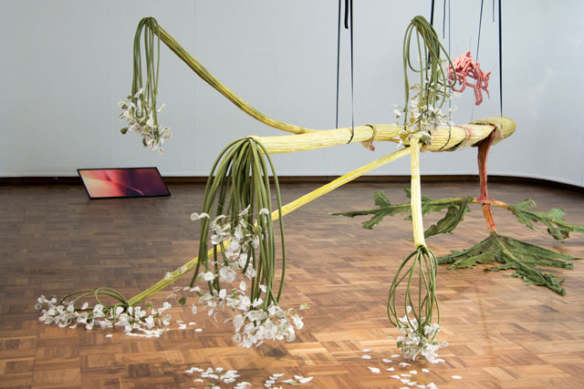 Ingela Ihrman. The Giant Hogweed, 2016. Paper, reed, glue, textile, spray paint, plastic, nylon string, ratchet strap. Courtesy Cooper Gallery, DJCAD and Ingela Ihrman.