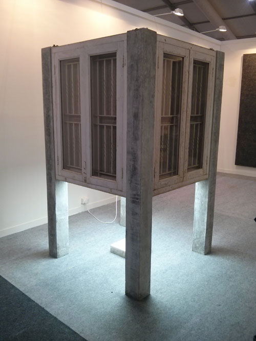 Abir Karmakar, Lighthouse, 2013. Found windows, concrete, iron pipes, plywood, household lights, 204.5 x 122 x 122 cm (80.5 x 48 x 48 in).