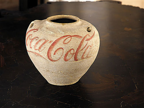 Ai Weiwei. Han Jar Overpainted with Coca-Cola Logo, 1995. Earthenware, paint, H. 9 7/8 in. (25 cm); Diam. 11 in. (28 cm). Lent by M+ Sigg Collection, Hong Kong. © Ai Weiwei.