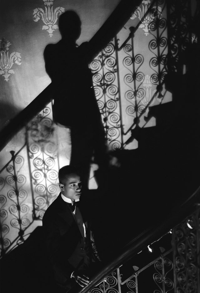 Isaac Julien. Film-­Noir Staircase (Looking for Langston Vintage Series), 1989/2016. Kodak Premier print, Diasec mounted on aluminium, 260 x 180 cm (102 3/8 x 70 7/8 in). Courtesy the artist and Victoria Miro, London. © Isaac Julien.