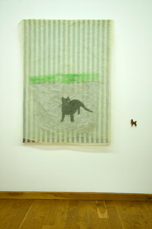 Jenny Watson. <em>Cat </em>2007. Acrylic on rabbit skin glue primed cotton, stretched, with organza overlay + small plastic horse, 128 cm x 91 cm. Courtesy Transit Gallery, Mechelen, Belgium.
