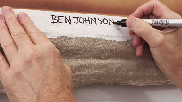 Ben Johnson signing the back of his painting Patio de los Arrayanes, September 2015. Photograph: Martin Kennedy.