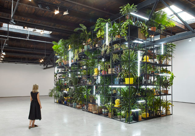 Rashid Johnson. Antoine's Organ, 2016. Black steel, grow lights, plants, wood, shea butter, books, monitors, rugs, piano, 480.1 x 858.5 x 321.9 cm (189 x 338 x 126 3/4 in).