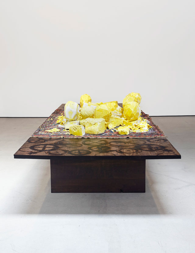 Rashid Johnson. Untitled (shea butter table), 2016. Shea butter, Persian rug, branded walnut, 139.7 x 517.5 x 184.2 cm (55 x 203 3/4 x 72 1/2 in).