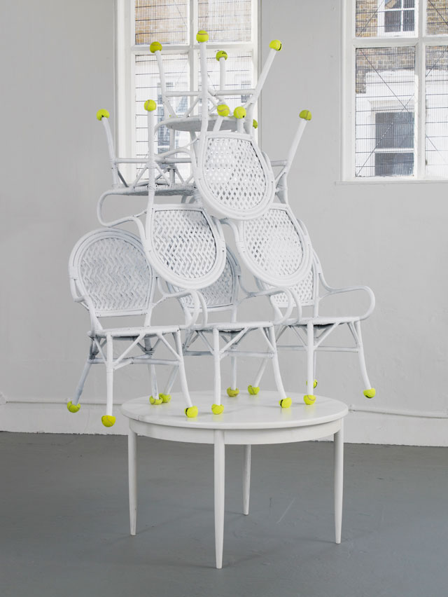 Jamian Juliano-Villani. Possession (Airbnb Poltergeist), 2016. Wicker chairs, teak table, emulsion, tennis balls, 179 x 269 x 122 cm. Courtesy of the artist and Tanya Leighton Gallery, Berlin. Photograph: Andy Keate.