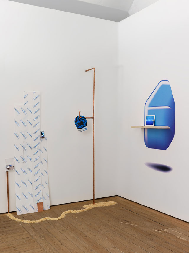 Sophie Jung. Nothing, It Just Waves (from Learning About Heraldry), 2013. Mixed media installation (spiral hat, copper, He Hells He Hells video on iPad, Lonely Rivers Flow video on iPhone, saw dust, wood, rosetta stone sticker, perspex). Photograph: Ceri Hand Gallery, Anna Arca.