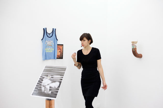 Sophie Jung. I wuz born this way...WHAT'S YOUR EXCUSE? (A miss spell to free yourself from the bonds of patriarchal undermining in the workplace), 2016. Performance, mixed media installation. (copper, leggins, t-shirt, wax, tar paint, magnets, window paint, oxidising paint, venus shells, fossilized worm poo, starbucks cup, swizzle sticks, paper clips, perspex, paint medium, photocopy). Photograph: Peter Burleigh.