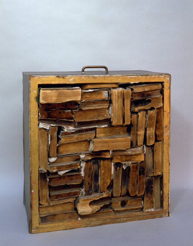 John Latham. Drawer with Charred Material, 1960. Drawer filled with books, plaster and vinyl, 55.9 x 55.9 x 27 cm. Collection of Nicholas Logsdail.