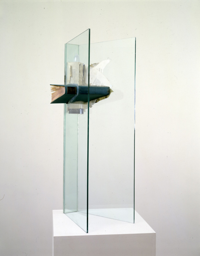 John Latham. Moral High Ground, 1988. Books, light bulb, glass, 83 x 25.5 x 33 cm. Courtesy John Latham Estate.