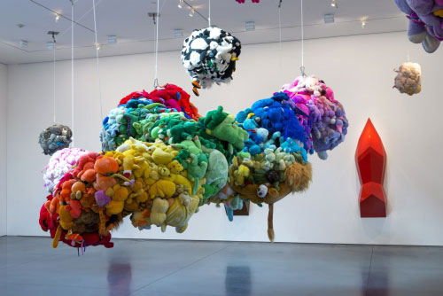Mike Kelley. Deodorized Central Mass with Satellites, 1991/1999. Plush toys sewn over wood and wire frames with styrofoam packing material, nylon rope, pulleys, steel hardware and hanging plates, fibreglass, car paint and disinfectant. Overall dimensions variable. © Estate of Mike Kelley. Images courtesy of Perry Rubenstein Gallery, Los Angeles. Photography: Joshua White/JWPictures.com.