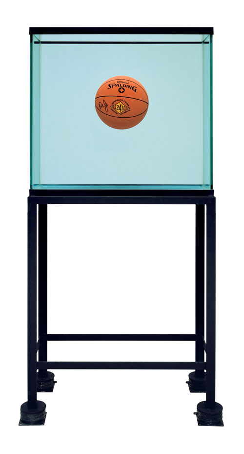 Jeff Koons. One Ball Total Equilibrium Tank (Spalding Dr. J 241 Series), 1985. Glass, steel, sodium chloride reagent, distilled water, basketball, 64 3/4 x 30 3/4 x 13 1/4 in (164.5 x 78.1 x 33.7 cm). Collection of B. Z. and Michael Schwartz. © Jeff Koons.